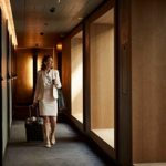 businesswoman-with-suitcase-at-hotel-corridor-3